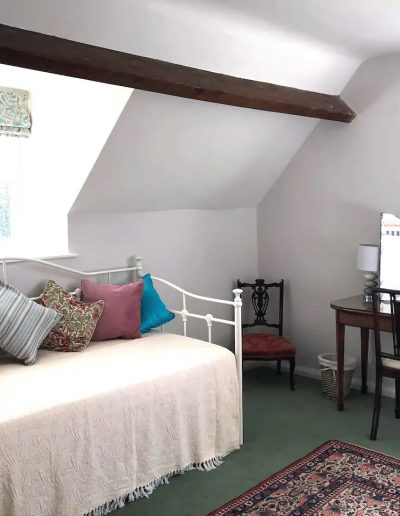 Another view of the third bedroom, showing the daybed.
